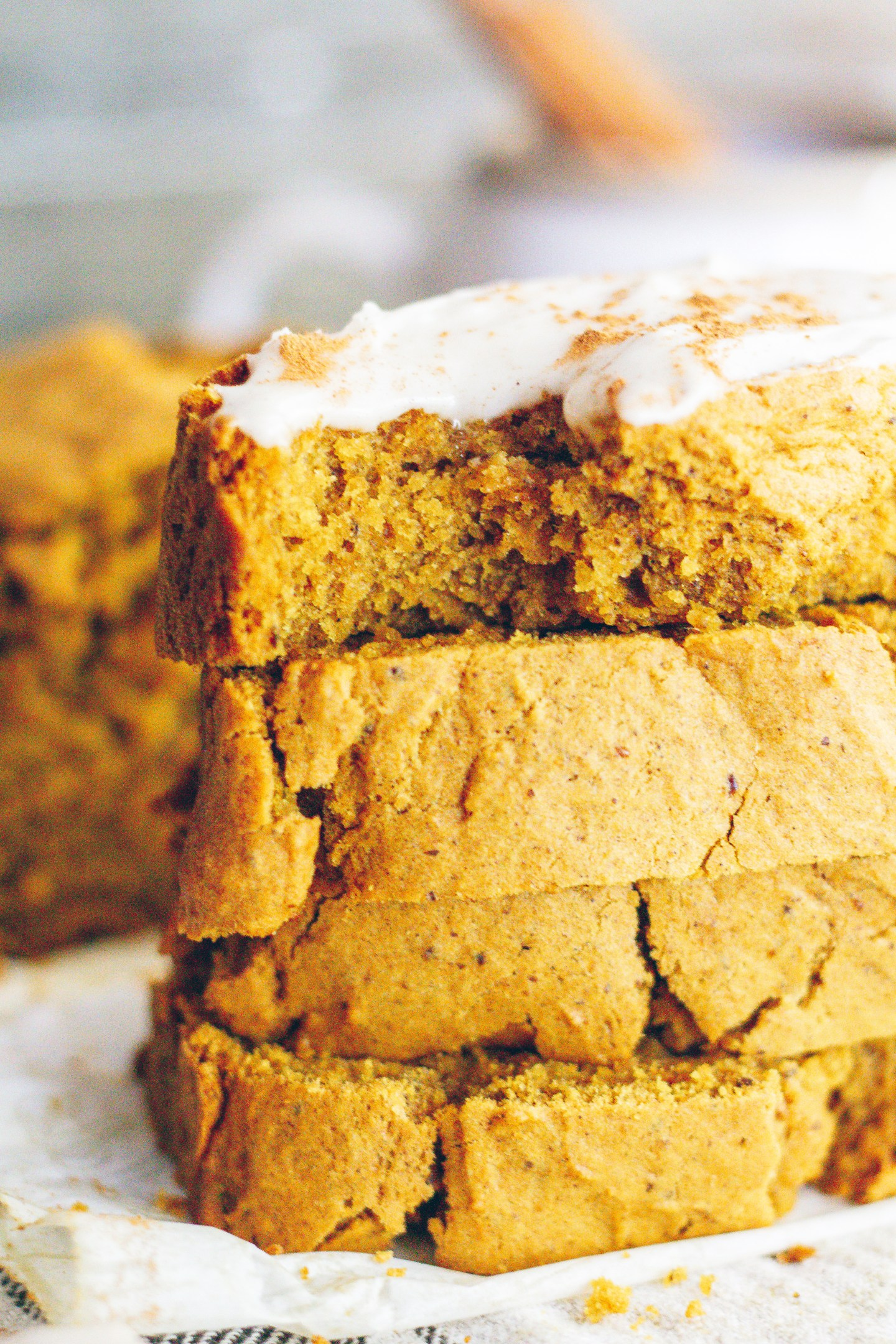 vegan pumpkin bread with maple cream cheese frosting